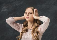 Confused woman puts her hands on the head. royalty free stock photo