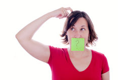 Confused woman with question mark on her mouth Stock Photography