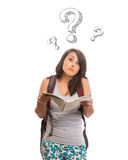 Confused woman with raised eyebrows holding map. Isolated Royalty Free Stock Image