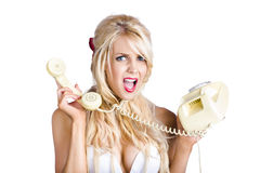 Confused woman with retro phone Stock Photography