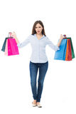 Confused woman with shopping bags Royalty Free Stock Image
