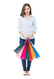 Confused woman with shopping bags Stock Photo