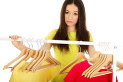 Confused woman thinking what to dress. Stock Images