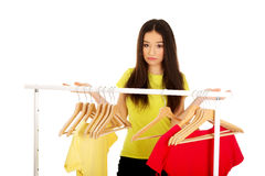 Confused woman thinking what to dress. Royalty Free Stock Photo