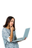 Confused woman using laptop Stock Photo