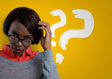 Confused woman wearing glasses scratching her head and question points. Digital composite of Confused woman wearing glasses scratching her head and question Stock Images