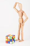 Confused wood mannequin stand next to puzzle confused before att. Empt to solve it Stock Photography