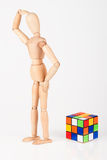 Confused wood mannequin stand next to puzzle confused before att. Empt to solve it Stock Images
