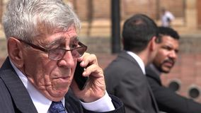 Confused Or Worried Ceo Or Senior Exec Talking On Phone stock footage