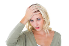 Confused young blonde looking at camera Royalty Free Stock Photos