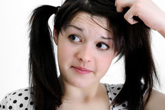 Confused young brunette woman Royalty Free Stock Photos