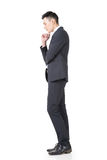 Confused young business man Stock Images