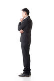 Confused young business man Royalty Free Stock Image