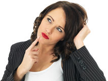 Confused Young Business Woman Thinking stock photo
