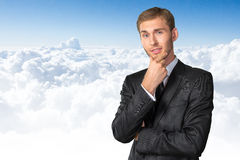 Confused young businessman thinking Stock Images