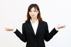 Confused young businesswoman Stock Photos