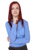Confused young businesswoman, hold her chin. Young confused attractive redhead businesswoman Stock Images