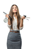 Confused young businesswoman holding office stationery isolated on white background Stock Image