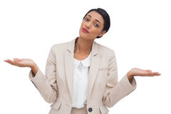 Confused young businesswoman. On white background Stock Images