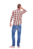 Confused young casual man Royalty Free Stock Photo