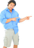 Confused Young Caucasian Male Pointing Stock Photography