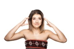 Confused beautiful girl thinking. Confused young girl thinking and making hand gestures Royalty Free Stock Photography