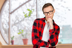 Confused young man thinking Royalty Free Stock Image