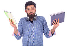 Confused young man. Unhappy confused beard young man holding tow note books, guy wearing blue shirt,  isolated on white background Stock Images