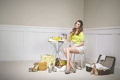 Confused young woman among shoes Royalty Free Stock Images