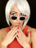 Confused Young Woman Wearing Sunglasses Royalty Free Stock Photo