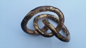 Confusing loops in five-fold knot. Cast in metal bronze as artwork royalty free stock photography