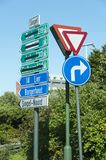 Confusing road direction signs in dutch informing drivers on street crossing Royalty Free Stock Photo