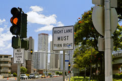 Confusing traffic signs. An intersection is littered with traffic signs and lights stock photo