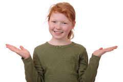 Confusion. Portrait of a redhaired girl in gesture of asking and confusion Stock Photo