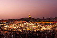Confusion in Djemaa el Fna square at sunset. Royalty Free Stock Image