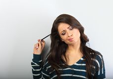 Confusion grimacing brunette woman thinking royalty free stock photography