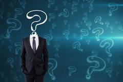 Confusion and inquiry concept. Question mark sketch headed businessman on blue background with copy space. Confusion and inquiry concept Royalty Free Stock Images