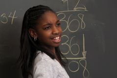 Confusion on a problem. A kid is confused on a math problem stock photography