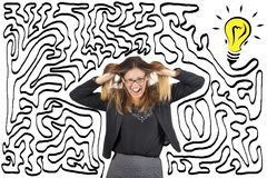 Confusion and stress. Maze and bulb. Reach the solution. Business woman stressed pulling her hair. Stock Photo