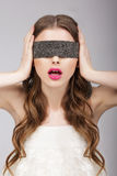 Confusion. Woman holding Headband on her Head Royalty Free Stock Image