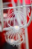 Confuso della candela nel canestro dell'annata della ruota Fotografia Stock