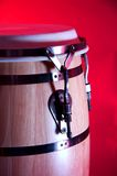 Conga Drum Red Brown on Red Bk. A red and brown conga drum isolated against a red background in the vertical format Stock Photos