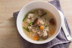 Congee asiático com carne de porco no branco Imagem de Stock Royalty Free