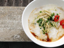 Congee. A bowl of congee on grunge background Royalty Free Stock Images