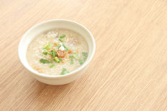 Congee bowl on wood texture Royalty Free Stock Images