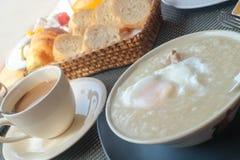 Congee con l'uovo ed il caffè Immagine Stock Libera da Diritti