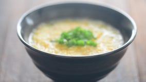 Congee de escavação do arroz da colher filme