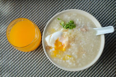 Congee with egg. Congee with pork and egg and vegetable on morning Royalty Free Stock Photo