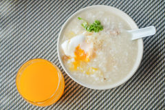 Congee with egg. Congee with pork and egg and vegetable on morning Stock Images