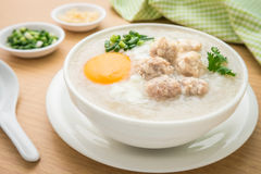 Congee with minced pork and boiled egg in bowl Royalty Free Stock Image
